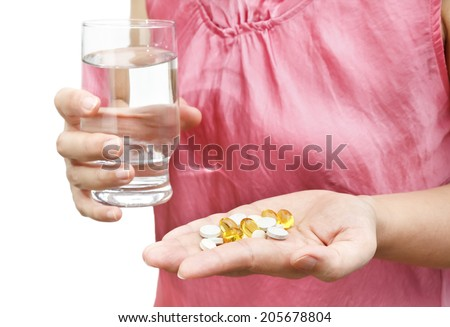 Woman hand with vitamins and supplements - stock photo