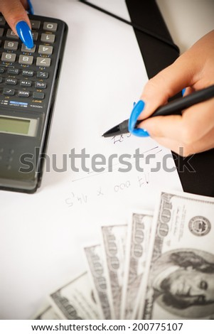 Woman hand working economic report. Close-up