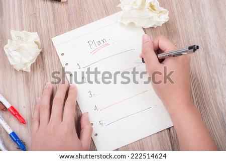 woman hand writing blank plan list - stock photo