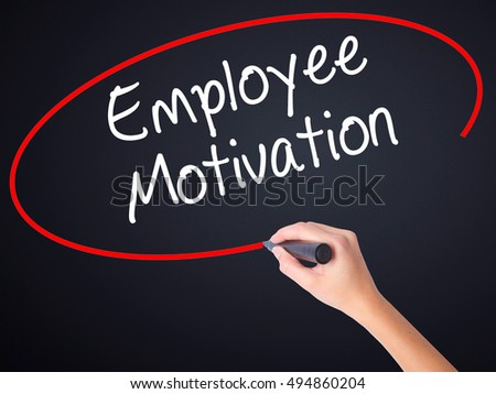 Woman Hand Writing Employee Motivation with a marker over transparent board . Isolated on background. Business, technology, internet concept. Stock 