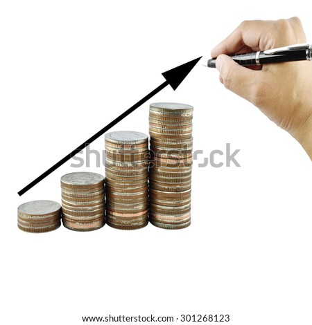 Woman hand writing graph on money growth concept in business, Coins on white background.