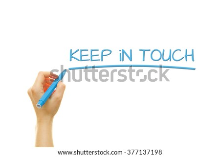 Woman hand writing keep in touch with marker on transparent wipe board.