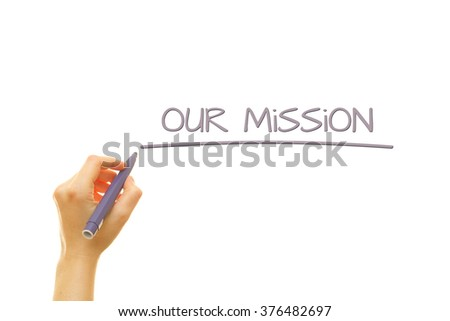 Woman hand writing Our Mission on a transparent wipe board. Business Concept. Mission of a Company.