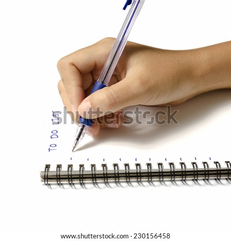woman hand writing with pen on notebook write to do word over white background