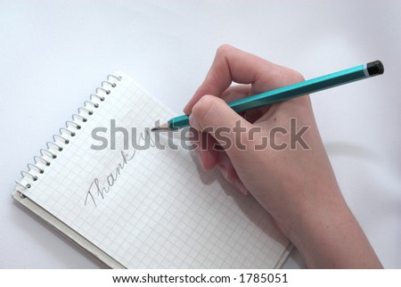 Woman hand writting a thanks message - stock photo