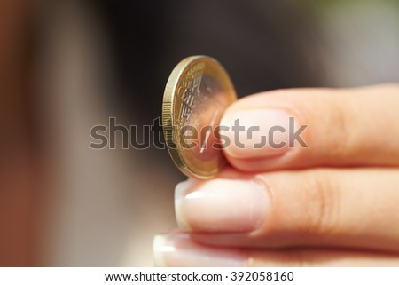 woman handing coins - stock photo