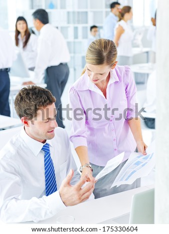 Woman Handing Documents to a Man - stock photo