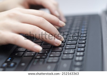 woman hands and computer on the background