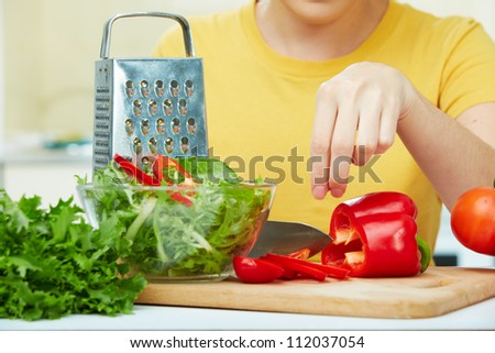 woman hands cooking  healthy food in the kitchen