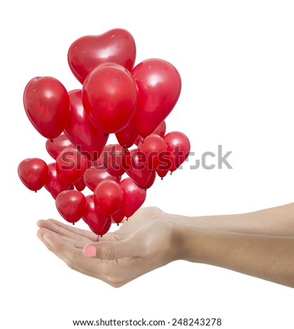 Woman hands giving a group red balloons - stock photo