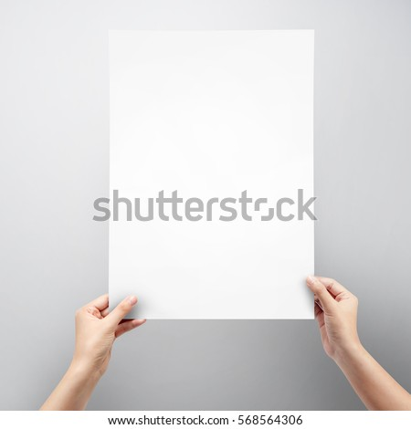 Woman hands holding blank paper sheet stock photo 568564306 woman hands holding blank paper sheet a3 size for poster on grey background publicscrutiny Gallery