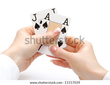 woman hands holding cards with 21 combination - ace and jack spades - blackjack