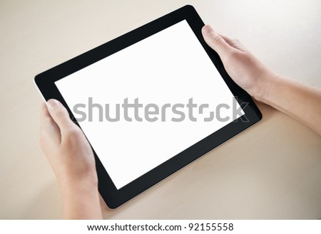 Woman hands holding contemporary digital frame with blank screen. - stock photo