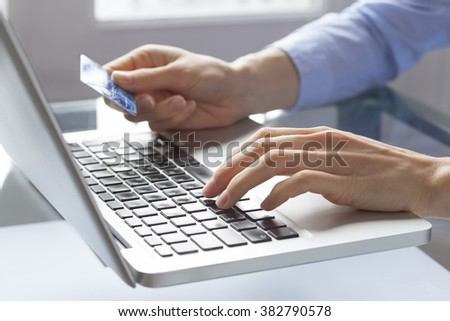 Woman hands holding credit card and typing on laptop, online payment on internet - stock photo