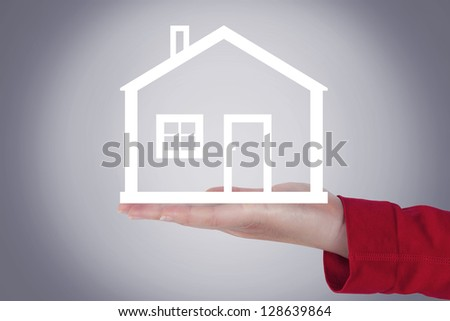 Woman hands holding house - stock photo