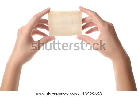 Woman hands holding old retro instant film transfer photo reversed on white background - stock photo