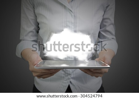 Woman hands holding smart tablet of black touchscreen with white cloud. - stock photo