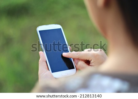 woman hands holding smartphone.