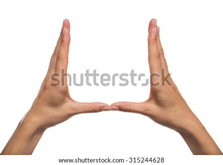 Woman hands holding something invisible, isolated on white. You can put any image or symbol between hands.