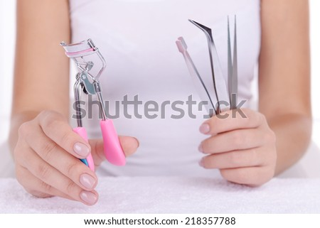 Woman hands holding tweezers close up - stock photo