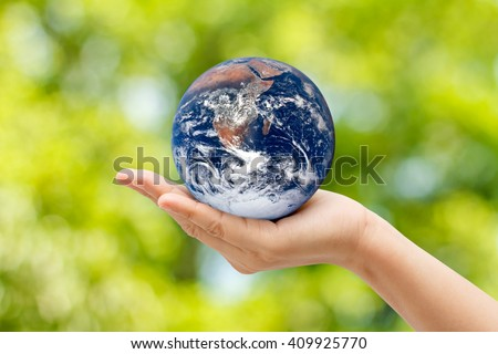 Woman hands in Globe on a natural background  . Elements of this image furnished by NASA,Concept Earth Day - stock photo