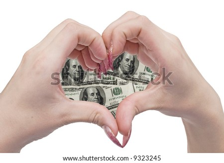 woman hands in the shape of a money heart