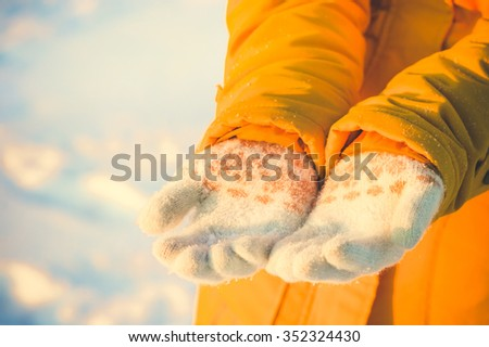 Woman Hands in Winter gloves Winter season Fashion Lifestyle vacations Outdoor - stock photo