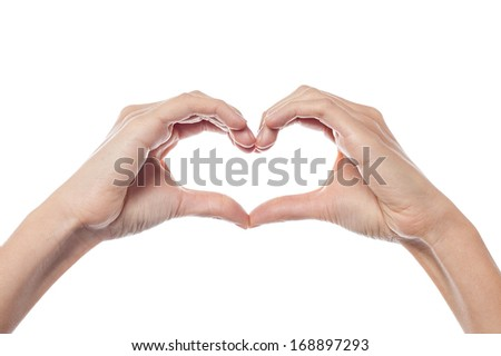 Woman hands make heart sign on the white background
