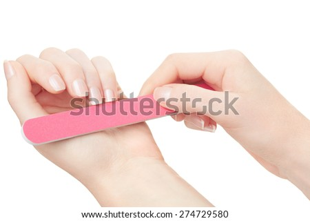 Woman hands manicure with nail file isolated on white, clipping path included - stock photo