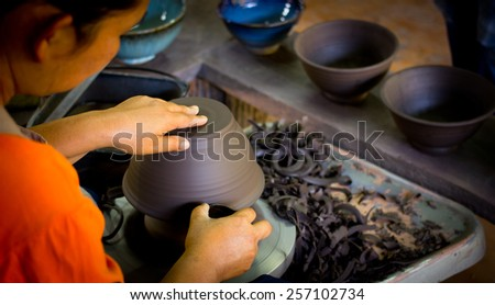 Woman hands of a potter, creating an earthen bowl ceramic of Chiang Rai Artist Thailand - stock photo