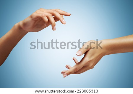 woman hands on a blue background