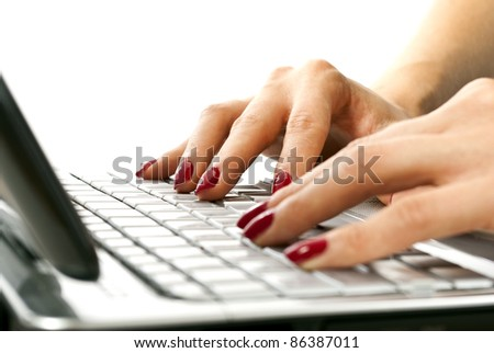 woman hands on netbook