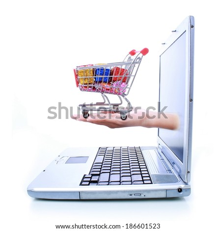 woman hands out of a laptop and holding a trolley, isolated on white background