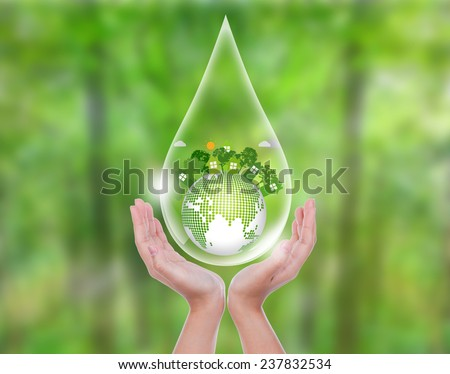 Woman hands over green forest hold water drop of  eco friendly earth - stock photo