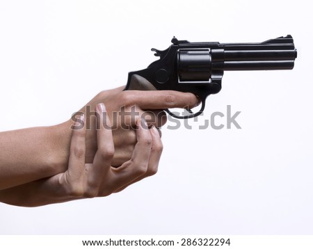 Woman hands, pointing a gun - stock photo