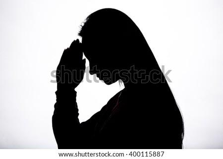 Woman hands praying silhouette