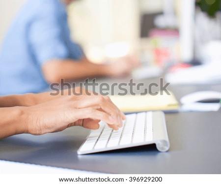 woman hands pushing keys of computer - stock photo
