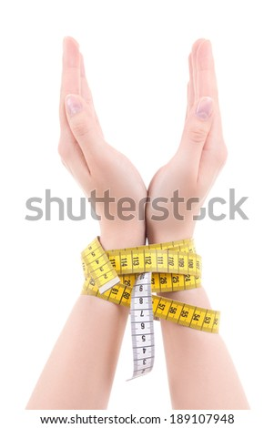 woman hands related with measuring tape isolated on white background - stock photo