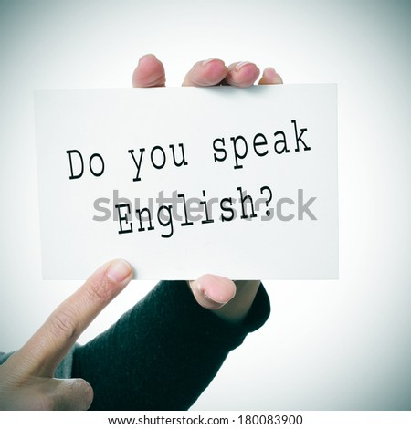 woman hands showing a signboard with the sentence do you speak english? written in it - stock photo