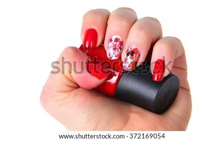 Woman hands with art modern red  manicure amd nail polish battle  isolated on the white.  - stock photo
