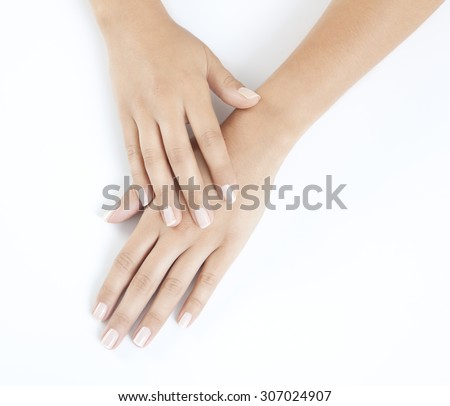 woman hands with beautiful fingernails against a white background