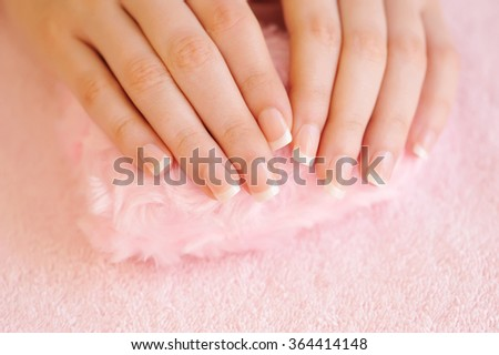 Woman hands with beautiful french manicure - stock photo