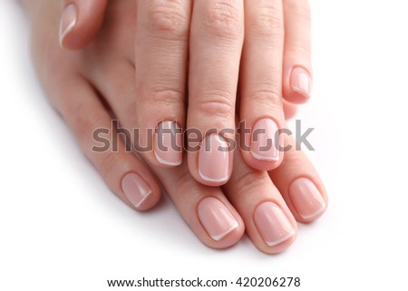 Woman hands with beautiful manicure isolated on white background - stock photo