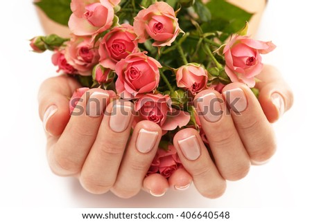 Woman hands with beautiful  roses on white background, close up - stock photo