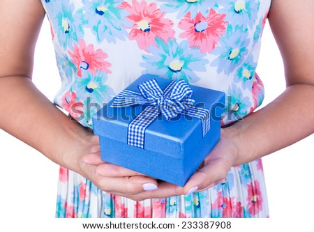 woman hands with blue bow gift box. Valentine's or christmas concept. - stock photo