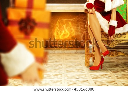 woman hands with boxes and santa claus woman legs