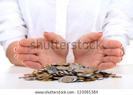Woman hands with coins, close up - stock photo
