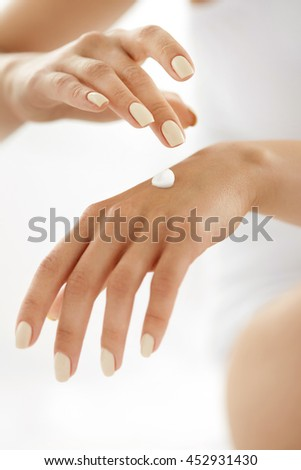 Woman Hands With Cream. Closeup Of Beautiful Female Hands With Natural Manicure Nails Applying Cosmetic Lotion On Healthy Soft Skin, Touching Cream On Her Hand. Beauty And Body Care Concept