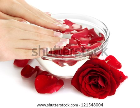 woman hands with glass bowl of water with petals, isolated on white - stock photo