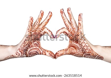 Woman hands with henna doing heart gesture isolated on white background with clipping path  - stock photo